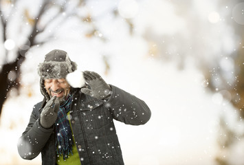 A man playing with snow