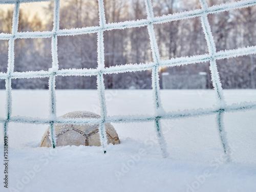 Leinwanddruck Bild Snowy soccer field