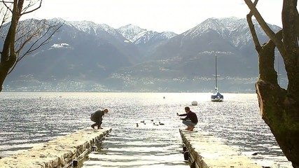 Couple takes picture by the lake