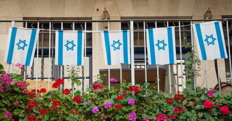 Garland of  Israeli flag on  balcony of  house