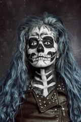 Women painted as skeleton