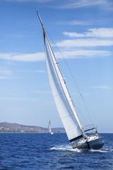 Sailing, racing yachts on the high seas. Luxury yachts.