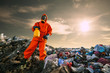 Recycling worker standing on the landfill - 75385269