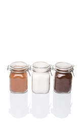 Instant coffee, chocolate drink powder and sugar in glass jar
