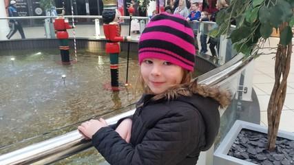 Happy girl at wishing fountain