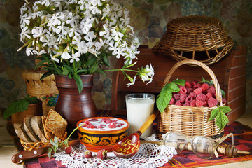 Rural still life with raspberries and milk