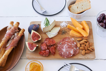 Overhead of gourmet cheese and meat platter