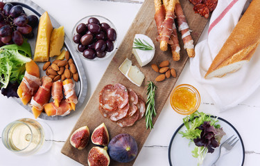 Overhead of selected cheese and cured meat platter for party sna