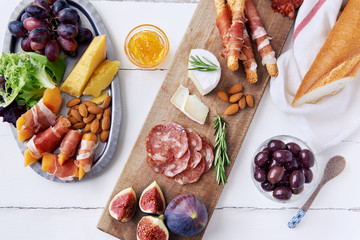 Overhead of gourmet cheese and meat platter for a party