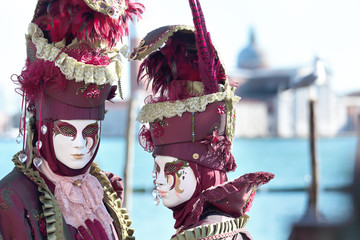 Couple of red masks at the Carnival of Venice