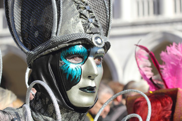 Silver and emerald mask at the Carnival of Venice