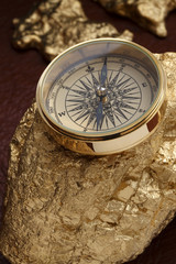 Gold nuggets and a compass