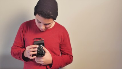 Young teen photographing vintage
