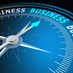 Business word on compass