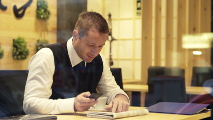 uccessful businessman with smartphone winning competition