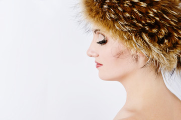 woman is wearing fur hat
