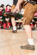 Leinwanddruck Bild - Men doing an austrian folk dance
