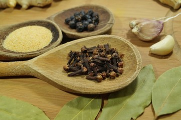 Spices and herbs on wooden spoons
