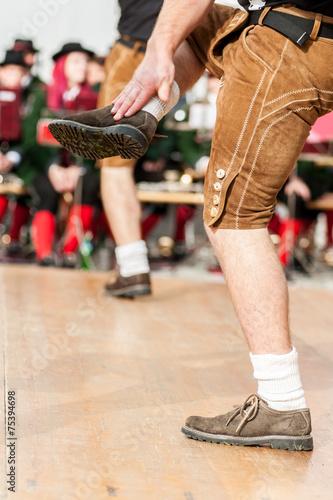 Leinwanddruck Bild Men doing an austrian folk dance