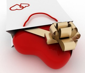 Box as heart form with a gold bow in a bag for a gift.
