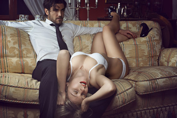 Beautiful woman in lingerie with elegant man