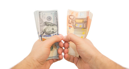 two hands holding dollars and euros isolated