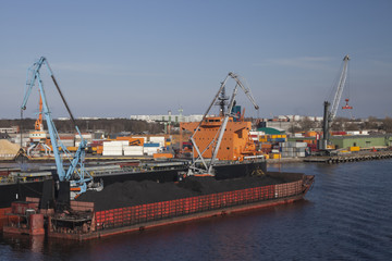 Coal charging in port of Riga city