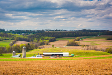 Spring view of farm fields and rolling hills in York County, Pen