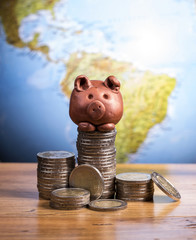 Brown piggy bank and coins