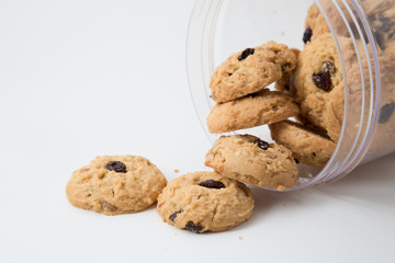 oatmeal raisin cookies spilling out of a jar