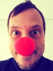 Man with red clown nose