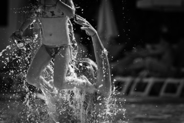 girl jumping in the pool