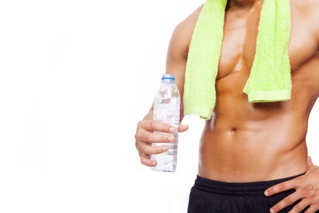 Fitness man holding a bottle of water, isolated on white backgro