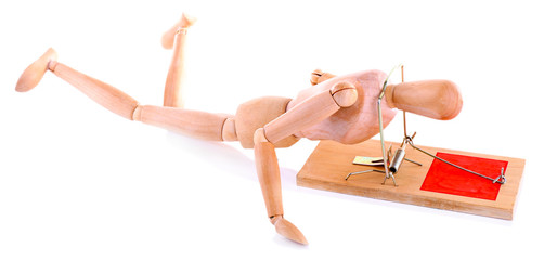 Mousetrap captured wooden mannequin, isolated