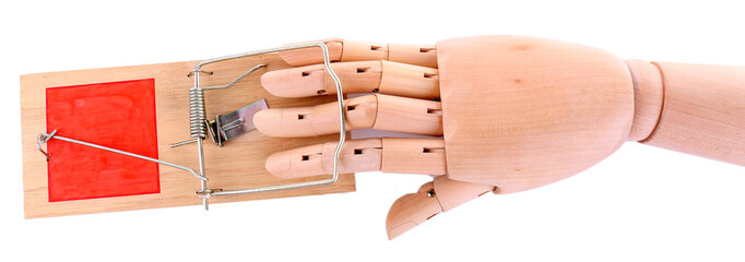Hand of wooden doll in mousetrap, isolated on white background