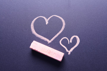 Drawing hart on board close-up