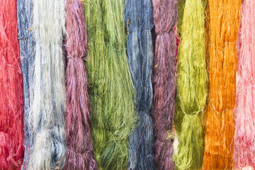 Colorful silk thread hung to be dried after dyeing