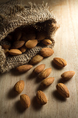 Closeup almonds nut with sack