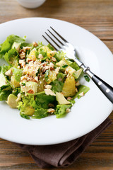 Salad with Avocado, Lettuce, Orange and Nuts