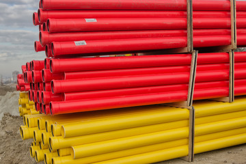 Stacks of various colored pvc pipes