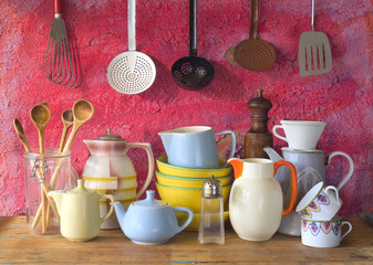 collection of vintage kitchenware, red background