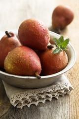 Red pears in metal bowl