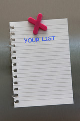 Your list on a note on a fridge door with magnet