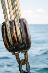 wooden pulley with two ropes, closeup