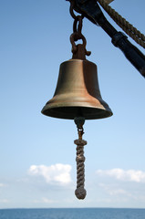 ships bell with blue sky