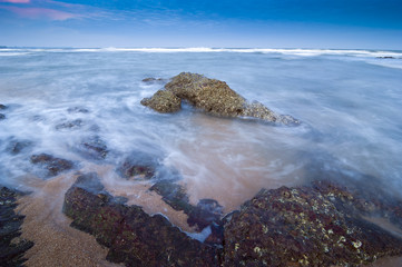 Beautiful seascape and rock in slow shutter speed