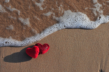 red hearts in the sand