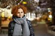 Curly hair lady outdoor, night urban scene