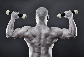 Strong man with minuscule dumbbells