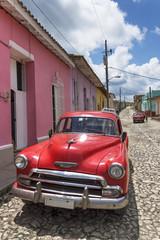 Classic american red car in Trinidad, Cuba